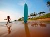 boy-running-surfboard